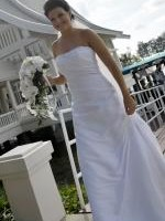 Strapless wedding dress with beaded detail by Christina Rossi