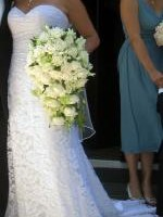 Elegant chantilly lace wedding dress by Mariana Hardwick