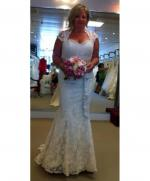 Brand new elegant lace wedding dress by Anastasia Collections