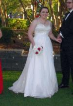 Beautiful custom made A-Line wedding dress with detail flowering and straps!